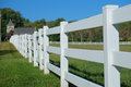 White rail fence a wooden leads to a country church Stock Photos