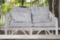 white rattan wicker swing bench with blue cushion and pillow in Royalty Free Stock Photo
