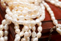 White real river pearls on wooden box Stock Photo