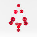 White and red buttons tree christmas background isolated on white with copy space unusual design Stock Photo