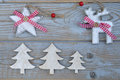 White red christmas decoration as christmas tree, reindeer and star on a old grey wooden planks background with empty copy space Royalty Free Stock Photo