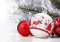 White and Red Christmas ornaments and fir tree branch on glitter bokeh background with space for text. Xmas and Happy New Year Royalty Free Stock Photo