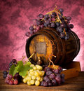 White and red grapes with wine barrel Stock Image