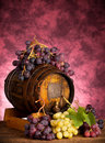 White and red grapes with wine barrel Royalty Free Stock Photo