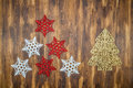 White and red shiny snowflakes decoration on wood, Christmas tre Royalty Free Stock Photo