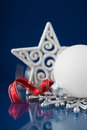 White, red and silver christmas ornaments on dark blue background Royalty Free Stock Photo