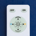 White remote control with the buttons on the blue background Royalty Free Stock Photo