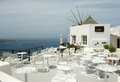White restaurant on santorini island windmill and sea landscape Stock Photography