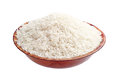 White rice in bowl raw isolated on background Stock Photos