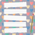 White ripped ruled notebook, copybook, note paper strips with pencil stuck on pattern created of colorful heart shapes