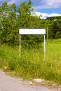 White roadsign near the road blank by summer Stock Photo