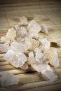 White rock sugar on the mat crystals of lying close up image Royalty Free Stock Image