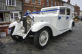 White rolls royce with decorated with blue ribbons for a wedding Stock Photo