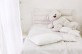 White room interior with bed window pillows and bear bedroom Stock Photography