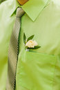 White rose boutonniere on green suit of the groom Royalty Free Stock Photo