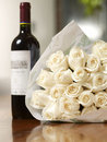 White roses bouquet, red wine Stock Images