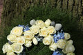 White roses on a sympathy wreath detail of with and blue hydranghea Stock Image