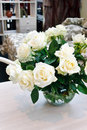 White roses on a table Stock Photo