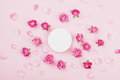 White round blank, pink rose flowers and petals for spa or wedding mockup on pastel background top view. Beautiful floral pattern. Royalty Free Stock Photo