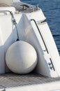 White round boat fenders for motor yacht are buffers the ship and the harbor Stock Image