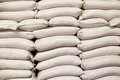 White sacks of rice in rice mill Royalty Free Stock Photo