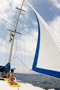 White sail and cloudy sky Royalty Free Stock Photos