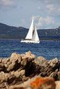 White sailboat in sardinia costa esmeralda italy Royalty Free Stock Photos