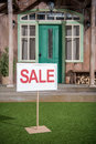 White sale banner standing near porch of new house Royalty Free Stock Photo
