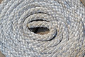 White sea cord on wooden surface round bulk focus center details Stock Photos