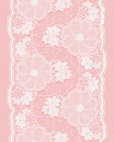 White seamless lace ribbon on pink background. Vertical border of floral elements. Royalty Free Stock Photo