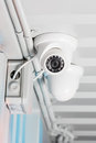 White security camera on ceiling
