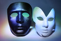 White serious and black masks (man and woman) Royalty Free Stock Photography