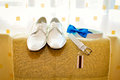 White shoes and strap a blue bow tie bowtie Royalty Free Stock Photos