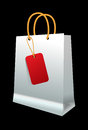 White shopping bag with paper handles on black background Stock Image