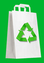 White shopping bag with recycle symbol on green Royalty Free Stock Photography