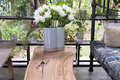 white siam tulip flower in vase on wood table in living room nea Royalty Free Stock Photo