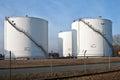 White silo tanks in a tank farm with blue sky Royalty Free Stock Photo