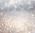 White silver and gold abstract bokeh lights defocused background Royalty Free Stock Photo