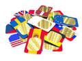 White sim card among colored ones cards in the form of flags of different countries Royalty Free Stock Photography