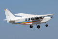 White single engine plane aircraft flying in blue skies Royalty Free Stock Image