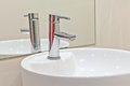 White sink, faucet and mirror Royalty Free Stock Photo