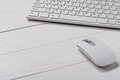 White slim keyboard with a white slim mouse Royalty Free Stock Photo