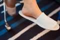 White slippers female feet with Royalty Free Stock Images