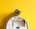 White smoke detector with nine volt battery Royalty Free Stock Photo