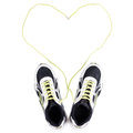 White sneakers with heart on white for running symbol isolated Stock Images