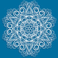 White snowflake abstract floral pattern blue background round pattern looks like crocheting handmade lace Stock Photography