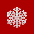 White Snowflake on red background. Winter symbol Royalty Free Stock Photo