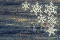 White snowflakes over rustic wooden background. christmas decora Royalty Free Stock Photo