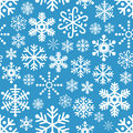 White Snowflakes Seamless Pattern on Blue