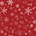 White snowflakes seamless pattern on red.